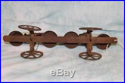 Antique Bell pull toy 1890s Boy and Girl figures, with weights that hit Bells