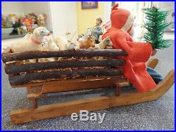 Antique German Santa Claus and Wooden Sled with Vintage Toys