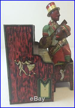 Antique HAM AND SAM The Minstrel Team wind up toy complete with figures
