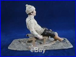 Unusual Heyde figure of a boy on an old style sled, winter or Christmas figure